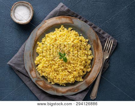 Bulgur Wheat. Boiled Bulghur Cereal In Plate On Dark Blue Stone Table. Healthy Vegetarian Food, Top