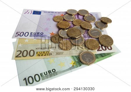 Euro Banknotes One Hundred  Two Hundred  Five Hundred And Euro Coins On White Background