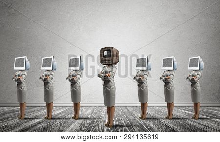 Business Women In Suits With Monitors Instead Of Their Heads Keeping Arms Crossed While Standing In