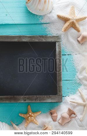 Summer Background. Wooden Background With White Sand And Seashells.shells, Starfish And Sand. Holida