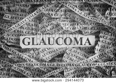 Glaucoma. Torn Pieces Of Paper With The Words Glaucoma. Concept Image. Black And White. Close Up.