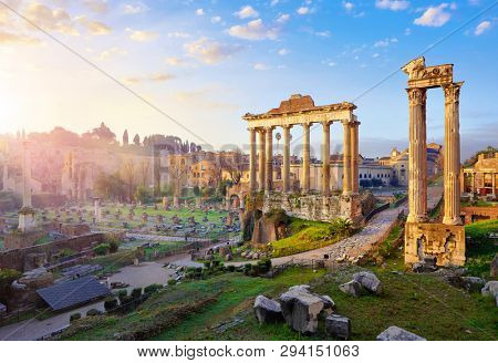 Roman Forum in Rome, Italy. Antique structures with columns. Wrecks of ancient italian roman town. Sunrise above famous architectural landmark.