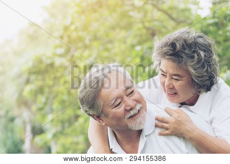 Happy Love Elderly Couple Smile Face , Senior Couple Old Man And Senior Woman Relaxing Hug In A Fore