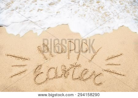 Happy Easter Background On The Sandy Beach Near Ocean. Hand Drawn Happy Easter Typography Lettering