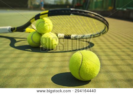 Tennis Balls And Racket On The Grass Court. Close-up. Concept Of Sport, Healthy Lifestyle.
