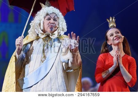 ST. PETERSBURG, RUSSIA - MARCH 25, 2019: Oleg Kulikovich (left) as King and Julia Korovko as Princess in the musical Town Musicians of Bremen during its press preview in Saint-Petersburg Music-Hall