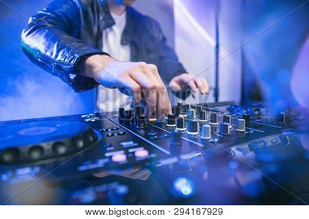 Dj Mixing At Party Festival With Blue Lights And Smoke In Background - Summer Nightlife View Of Disc