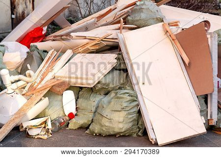 A pile of trash, garbage and old furniture submitted for disposal in the trash poster
