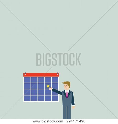 Businessman Standing And Pointing To Calendar With Star. Man In Suit Presenting Colorful Bulletin Bo