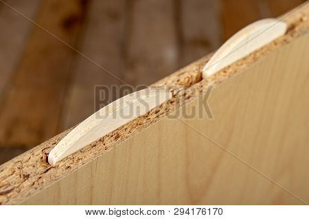 Gluing chipboards in the workshop using sipes. Minor carpentry work in the woodworking shop. Light background. poster
