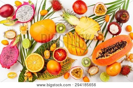 Still life with fresh assorted exotic fruits on a palm leaf. Concept of healthy eating with fruits. Top view.