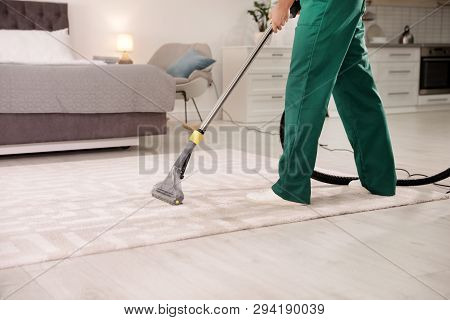 Professional Janitor Cleaning Carpet In House, Closeup