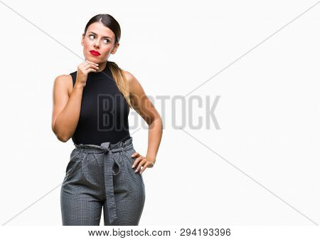 Young beautiful elegant business woman over isolated background with hand on chin thinking about question, pensive expression. Smiling with thoughtful face. Doubt concept.