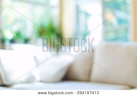 Blurred Home Interior Background With Couch And Natural Light