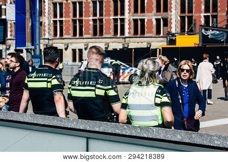 Amsterdam Netherlands April 8, 2019 View Of Dutch Police Officers Front Central Station In Amsterdam