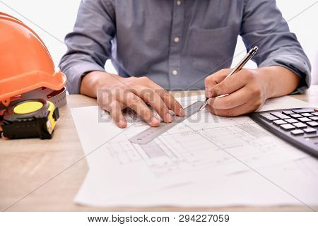 Engineering Concept. The Engineer Is Working In The Office. Engineers Are Designing Their Work Calcu