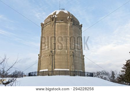 Historic Landmark Water Tower Listed On National Historic Register Atop Snow Covered  Hill In Tangle