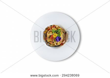 Stir-fried Spicy Spaghetti With Seafoods On White Background. Top View