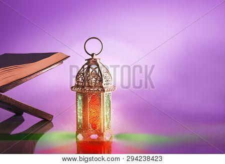 Arabic Lamp With Beautiful Light And Holy Koran. Islamic Concept Image For Ramadan
