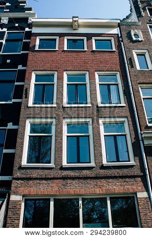 Amsterdam Netherlands April 8, 2019 View Of The Facade Of A Old Dutch Building Located In The Red Li
