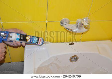 Kyiv, Ukraine - March, 12, 2019: Bath Tube Installation With Silicone Bathroom Caulk, Water Tap In T