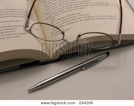 Glasses, Book, And Pen