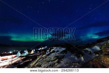 Northern Lights Over The Inuit Village, Fjord And Mountains, Nearby Nuuk City, Greenland