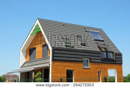 Modern Passive House Exterior. Modern Energy Efficiency House With Skylight Windows And Solar Panels