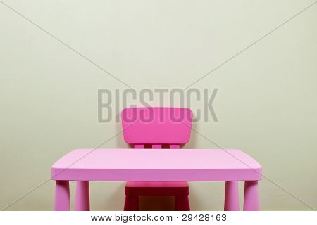 Kids Desk And Chair Against The Wall