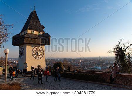 Graz,styria, Austria - 20.01.2019: Schlossberg Castle Mountain In Graz, People Walking Pass The Cloc