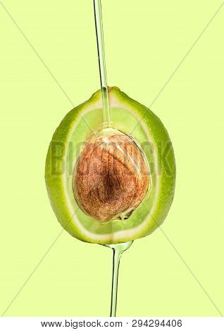 A Paradox And Hidden Sense Or Deepest Idea. Lime Outside And Avocado Inside And Pouring Oil Against