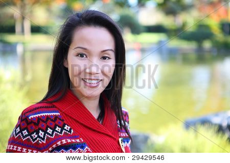 A pretty young asian woman enjoying nature in the park