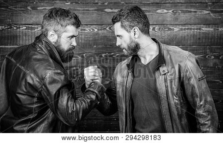 Brutal Bearded Men Wear Leather Jackets Shaking Hands. Strong Handshake. Friendship Of Brutal Guys.