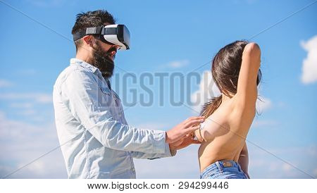 Man touch sexy naked erotic breasts virtual girl. Explore cybersex. Play virtual sex game. Intimate sensation concept. Hipster man play virtual sex game hmd or vr glasses. Virtual sexual activity poster