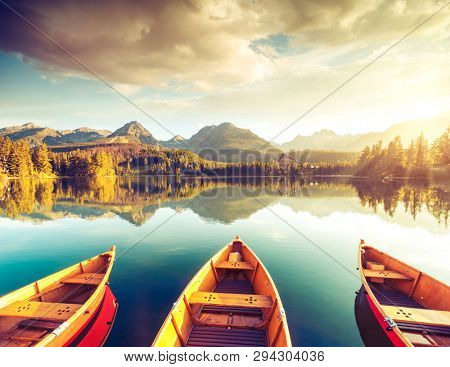 Calm lake in National Park High Tatra. Location place Strbske pleso, Slovakia, Europe. Photo toned style instagram filters, vintage effect. Scenic image of popular travel destination. Beauty of earth.