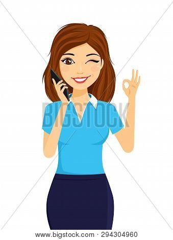 Portrait Of A Young Girl With A Mobile Phone. The Girl Holds A Mobile Phone In Her Hand And Winks. F