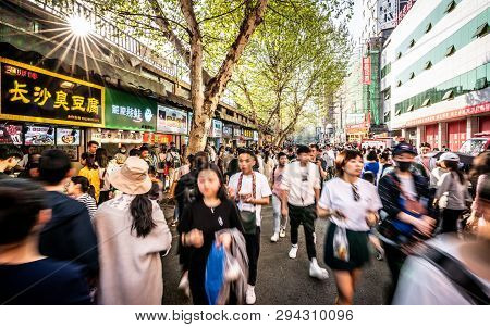 6 April 2019, Wuhan Hubei China : Moving Forwad Crowd Of Chinese People In Streetfood Street In Wuha
