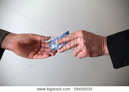 Businessman giving out his card