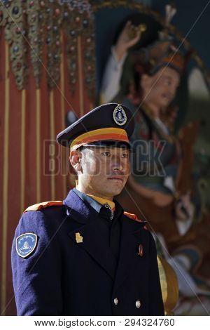 THIMPHU, BHUTAN - DEC 3, 2017: Royal honour guard on duty in front of the Tashichho Dzong, Thimphu, Bhutan. This is Buddhist Monastery and Fortress where the civil government office located.