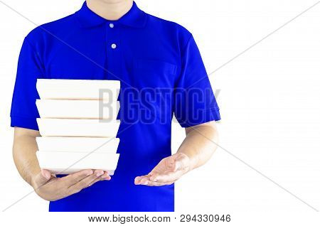 Food Delivery Service Or Order Food Online. Delivery Man In Blue Uniform With Hand Holding Paper Pac
