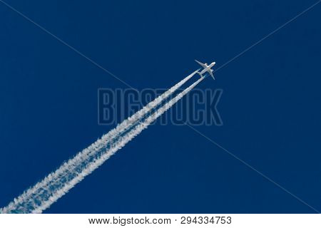 Airplanes Leaving Contrail Trace On A Clear Blue Sky