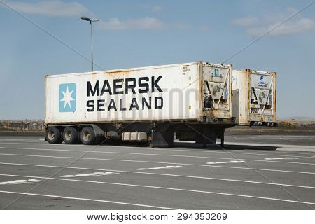 LANDEYJAFOFN, ICELAND - CIRCA 2015: Cargo shipping containers of Sealand, a division of Maersk group, on truck trailers in a parking lot in Iceland