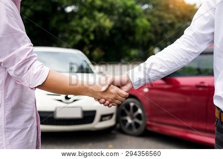 Customer Shake Hand With Auto Insurance Agents Examining Car Crash Owner After Agreeing Find A Frien