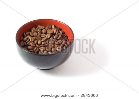 A simple bowl of coffee beans. [Isolated on white background.] poster