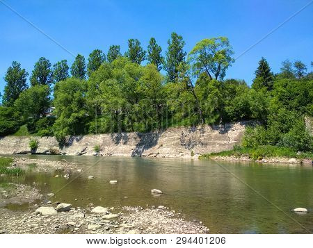 The Cheremosh River In Ukrainian Carpathians Near Verkhovyna At Sunny Summer Day