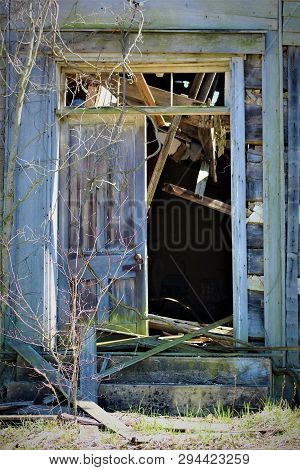 A Weathered Set Of Double Doors Mark The Entrance To This Collapsing Church In Rural Kentucky.