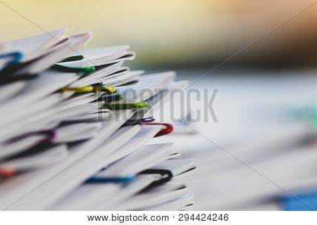 Close Up Pile Of Unfinished Paperwork On Office Desk Waiting To Be Managed And Inspected. Stack Of H