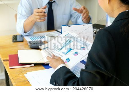 business businessman in meeting analyses chart graphy marketing plan in business financial  audit project. Or Business adviser analyzing poster