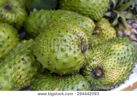 Soursop, Guanabana Or Custard Apple Or Annona Muricata And Green Coconut On Street Market In Ubud, I