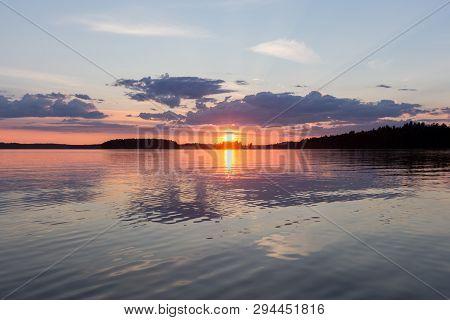 A Beautiful Sunset At Calm Lake. Finland